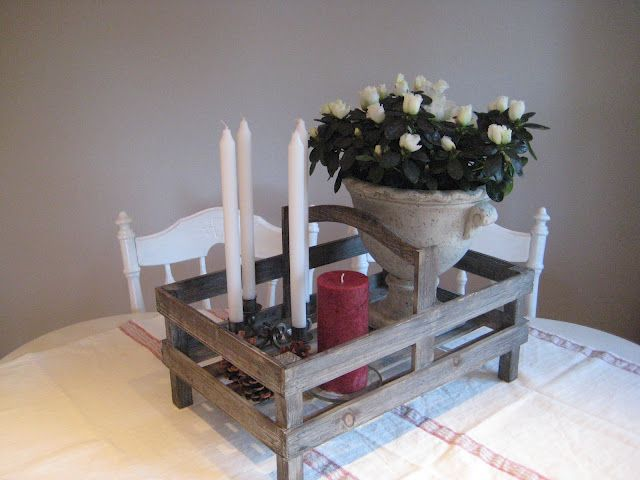 I love the wooden tray/hold all ... filled with candles and antique glass ornies ...