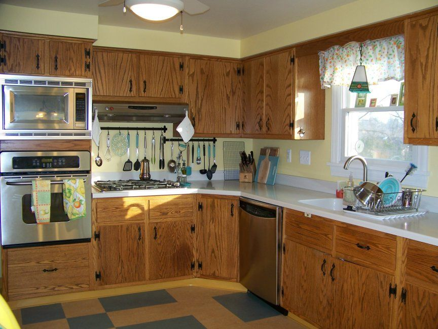 diana 39 s early 60s oak kitchen with plank doors and