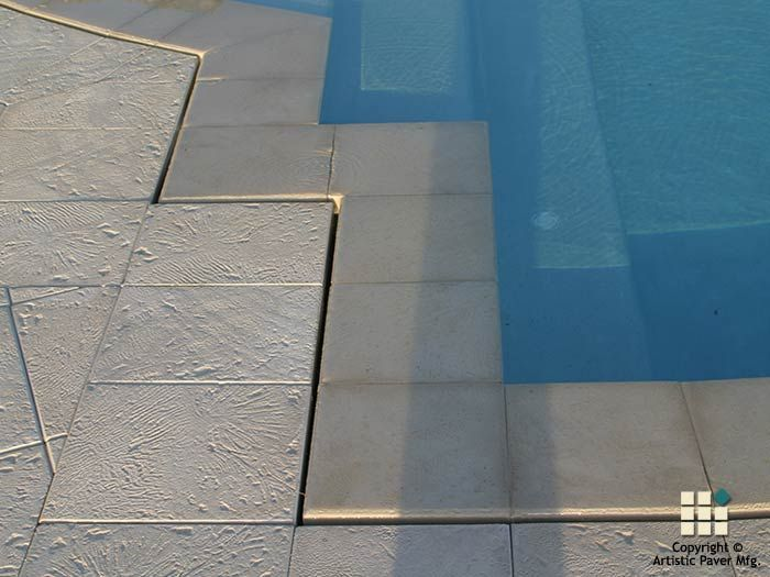 Corallock<sup>®</sup> pavers in the color Ivory used in wet-edge pool detail.
