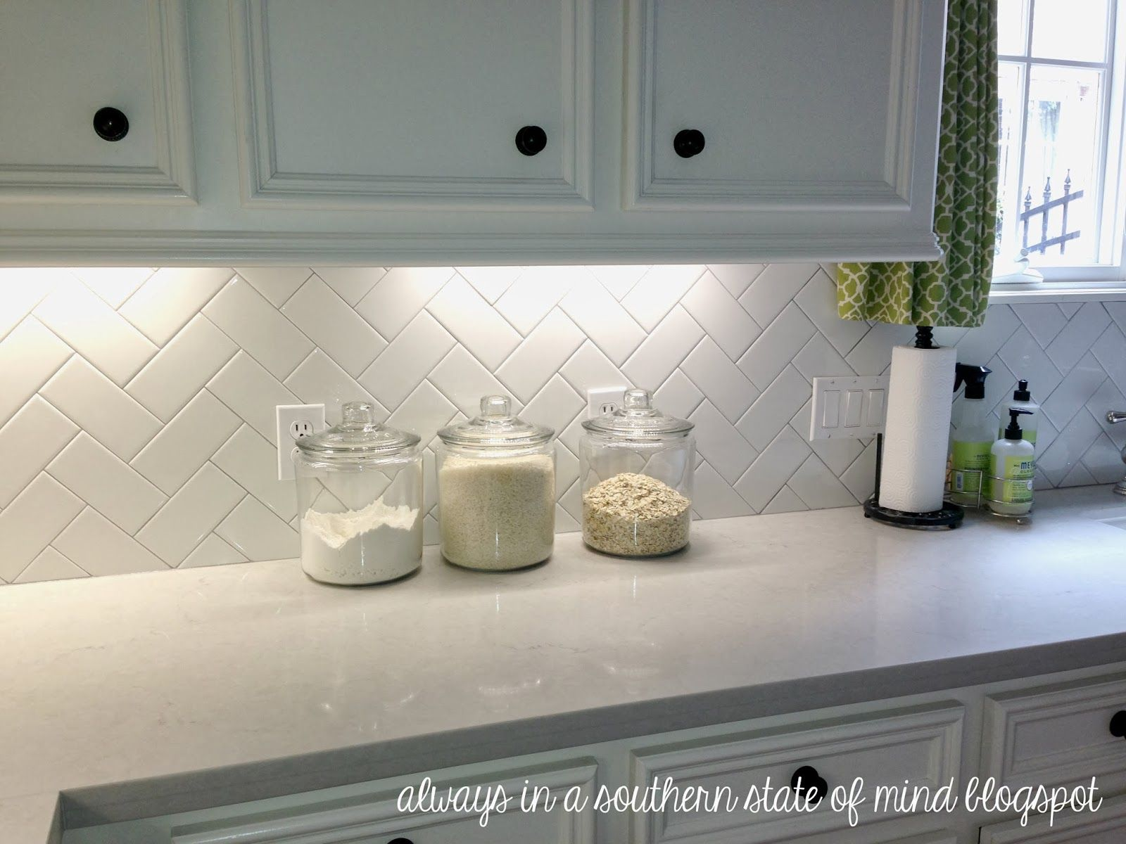 London Grey Countertop white cabinets and herringbone subway tiles ...