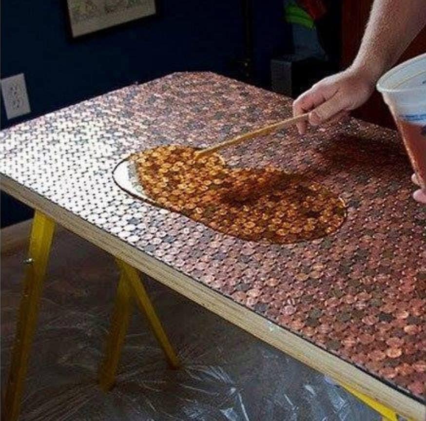 cubrir mesa con monedas de 1 centavo