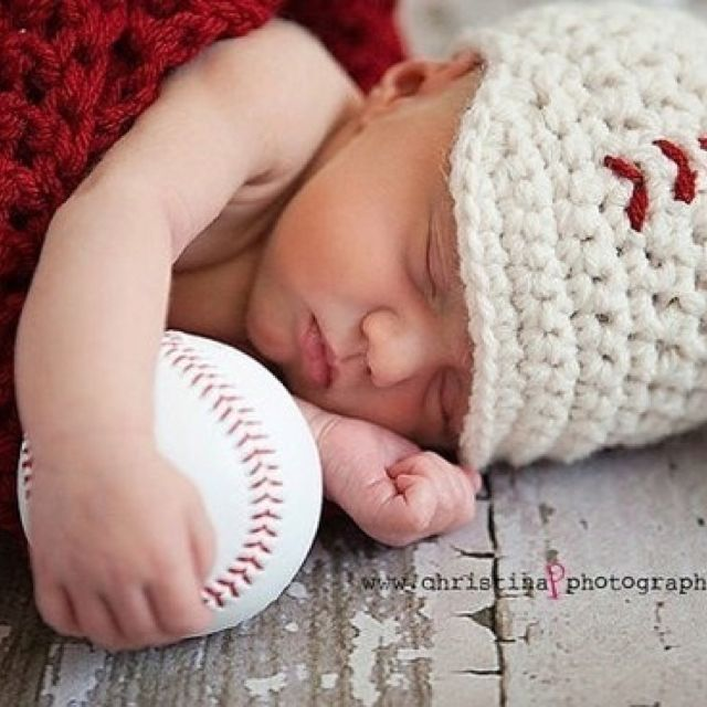 Baby picture idea for a boy...football instead :) Roll tide!