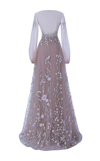 The Belle Blossom Fairy Dress   This Hamda al Fahim gown features full pastel colored embroidery, illusion neckline and bell sleeves, with an illusion-partially exposed back.  •Hidden side zip •Composition: tulle •Color: nude •Partially lined •Made in United Arab Emirates
