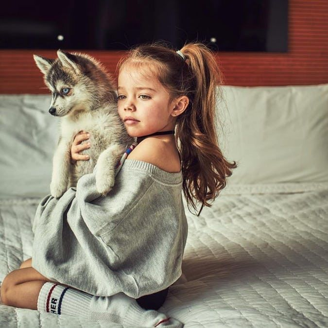 Not too wacky, but definitely not ordinary, here are 25 stunning baby girl names that teachers have only heard once. little girl with a puppy