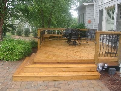 Wood Deck With Baroque Pickets Down To Patio