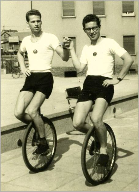 Gay couple on unicycles.