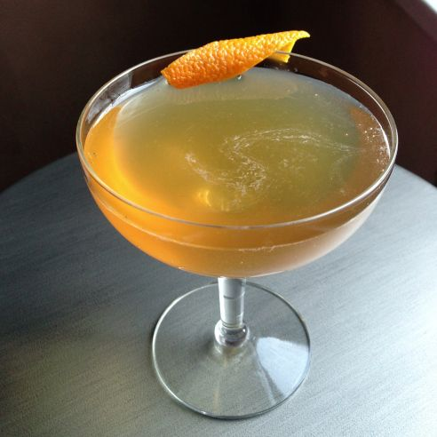 Income Tax Cocktail: 1.5oz Gin .75oz Dry Vermouth .75oz Sweet Vermouth .5oz Orange Juice1 dash Angostura Bitters Orange Twist