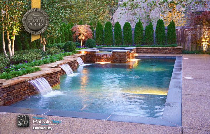 Wonderful Pool Finish Ideas For You To Copy: Raised Green Wall Of Evergreens Around Perimiter Fence