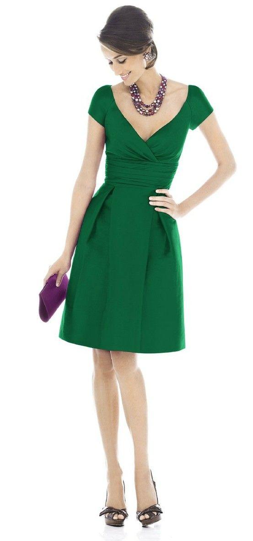 green dress, black pumps, black bib necklace