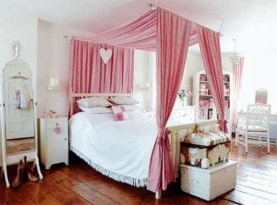 Girls room.  Love how they used the curtain rods to make a canopy.