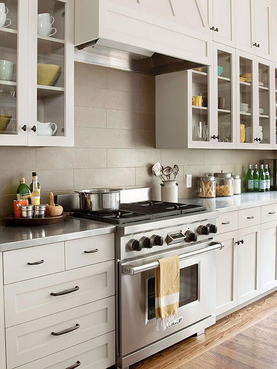 Stainless Steel Countertops Stand Out In This Classic Taupe Kitchen