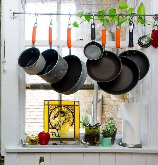 Making It Work Hanging Pots And Pans In Front Of A Window Pot Rack Kitchen Hanging Pots Small Kitchen Storage Solutions