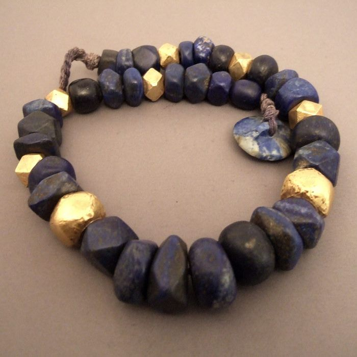 """A ashtonishing necklace in lapis lazuli and gold :30 old beads in """"mat"""" lapis lazuli of the highest quality from Afghanistan and 8 (22ct) gold facetted beads from Radjasthan (India) and a super button in lapis in shape of a button ... this necklace from early 20th century is really exceptional for its size and its strenght ... weight : 188gr Lenght :46,5cm/18,30 inch  For sale now in my shop at 28, Galerie du Roi at 1000 Brussels and today afternoon on my website www.halter-ethnic .com  ..."""