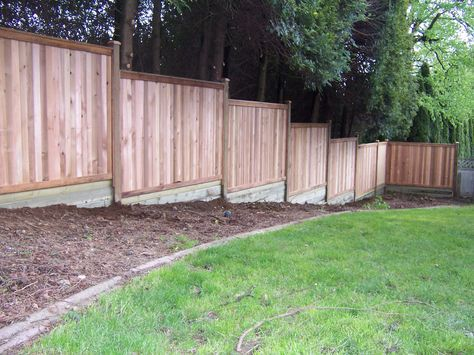 building fence sloped ground