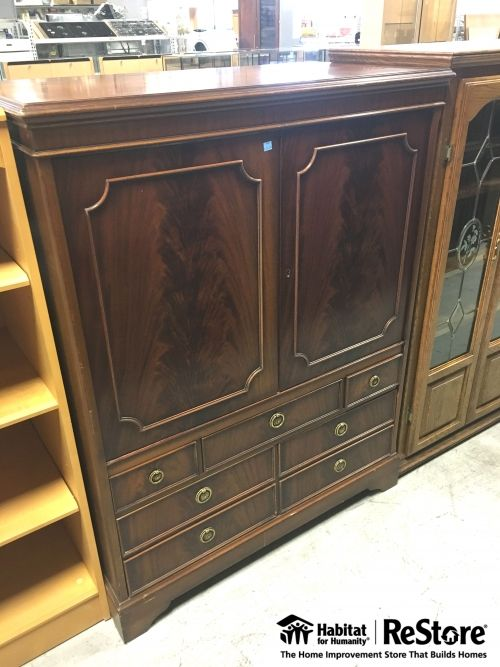 This beautiful entertainment unit could also be used perfectly as an armoire! It's complete with beautiful exterior details and spacious drawers. It's available for pick up at the Santa Ana ReStore to...
