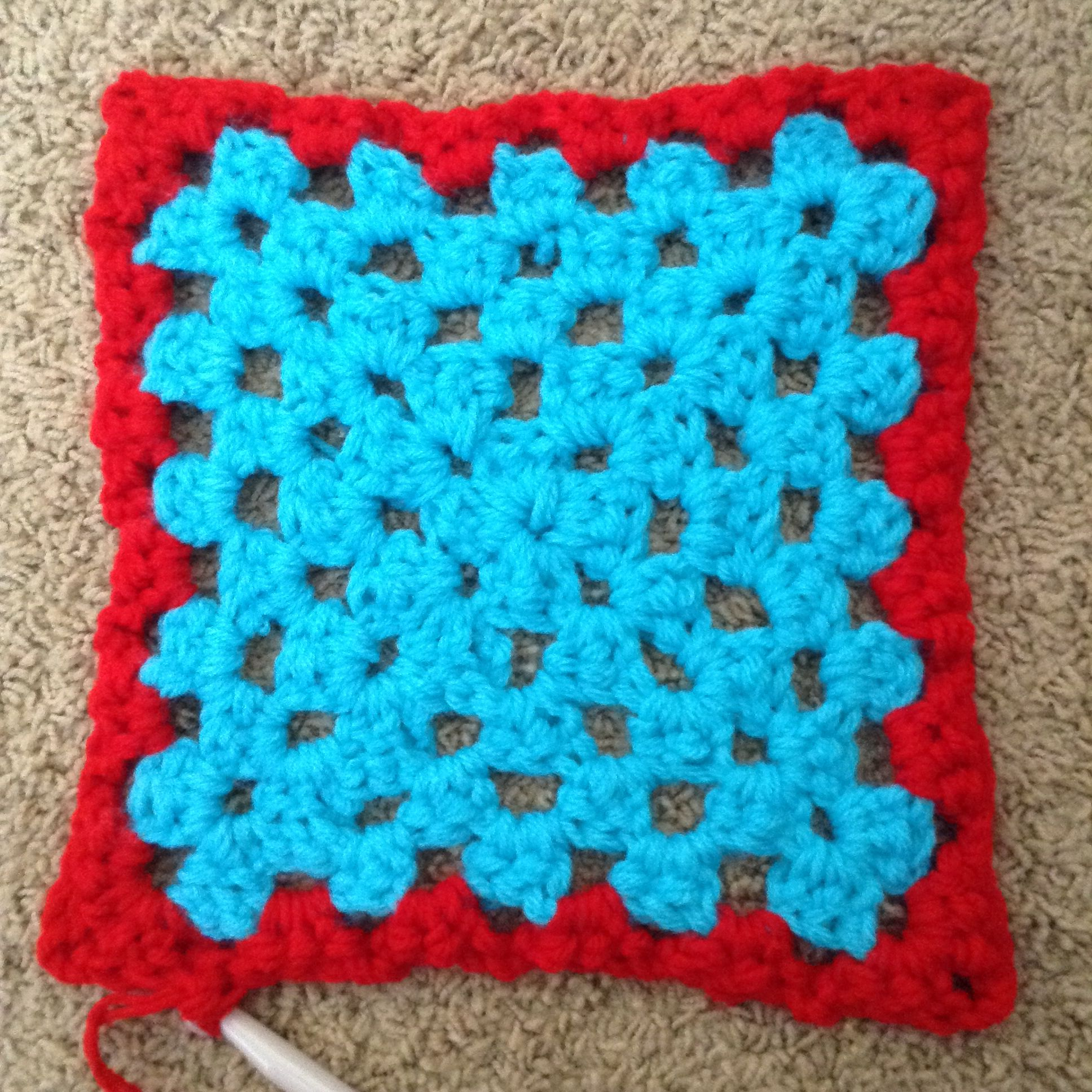 Crocheted granny square.