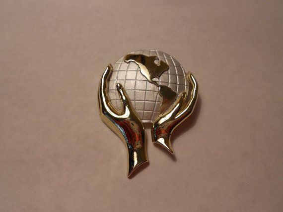 Vintage Hands holding the World Pin by 2DamesDesign on Etsy