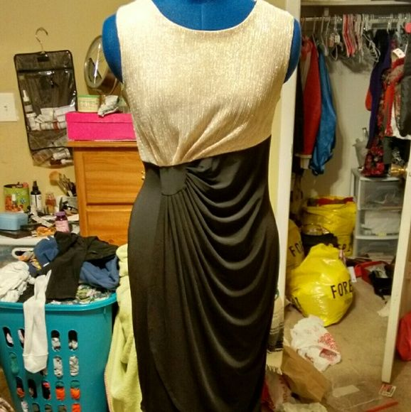 Gold and black dress petite size A nice dress with pretty draping to flatter any figure. The gold top is very nice and shimmery. Only worn once, in perfect condition. Dresses