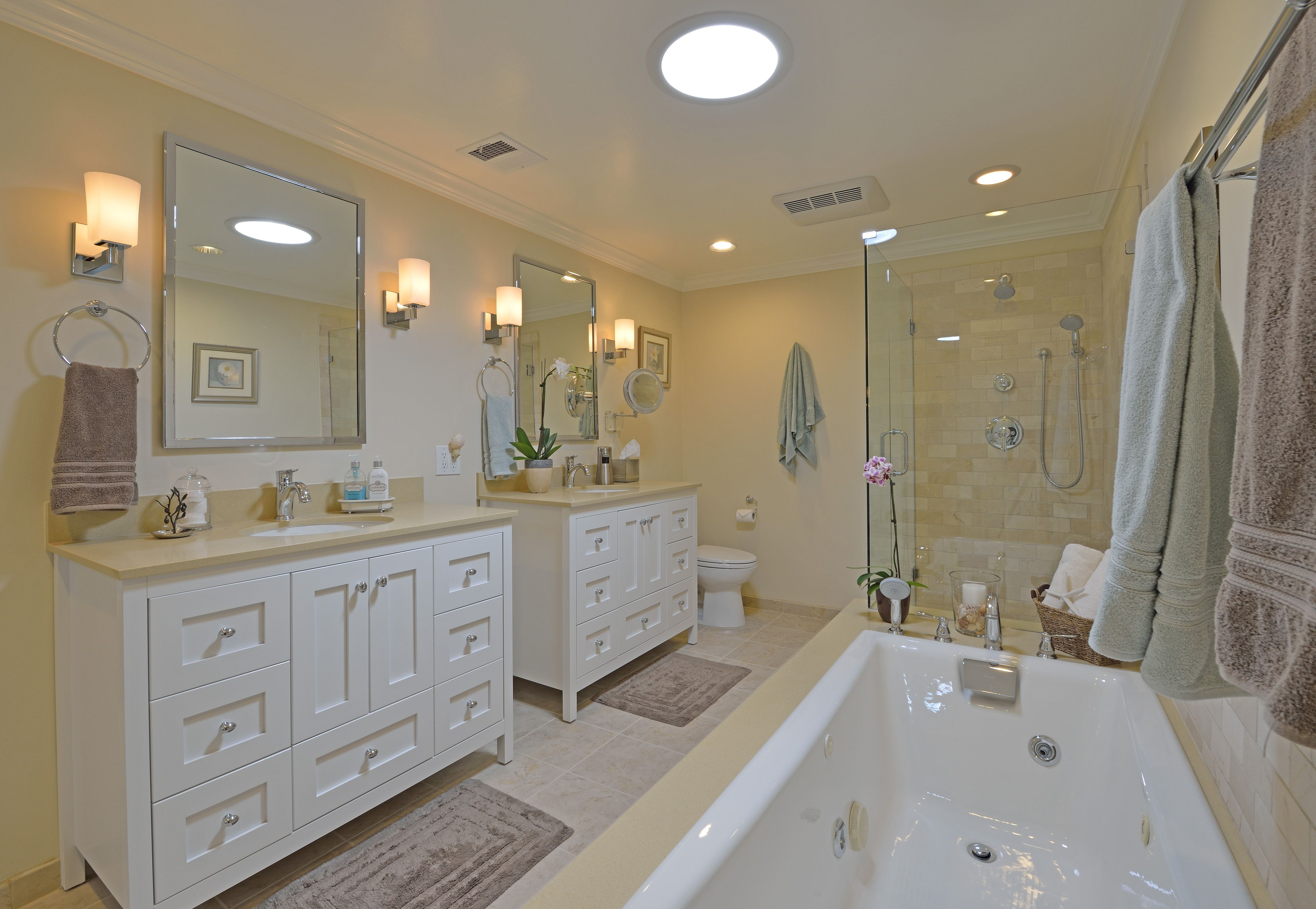 This appealing all white master bath includes a pair of for Vanity bathroom ideas