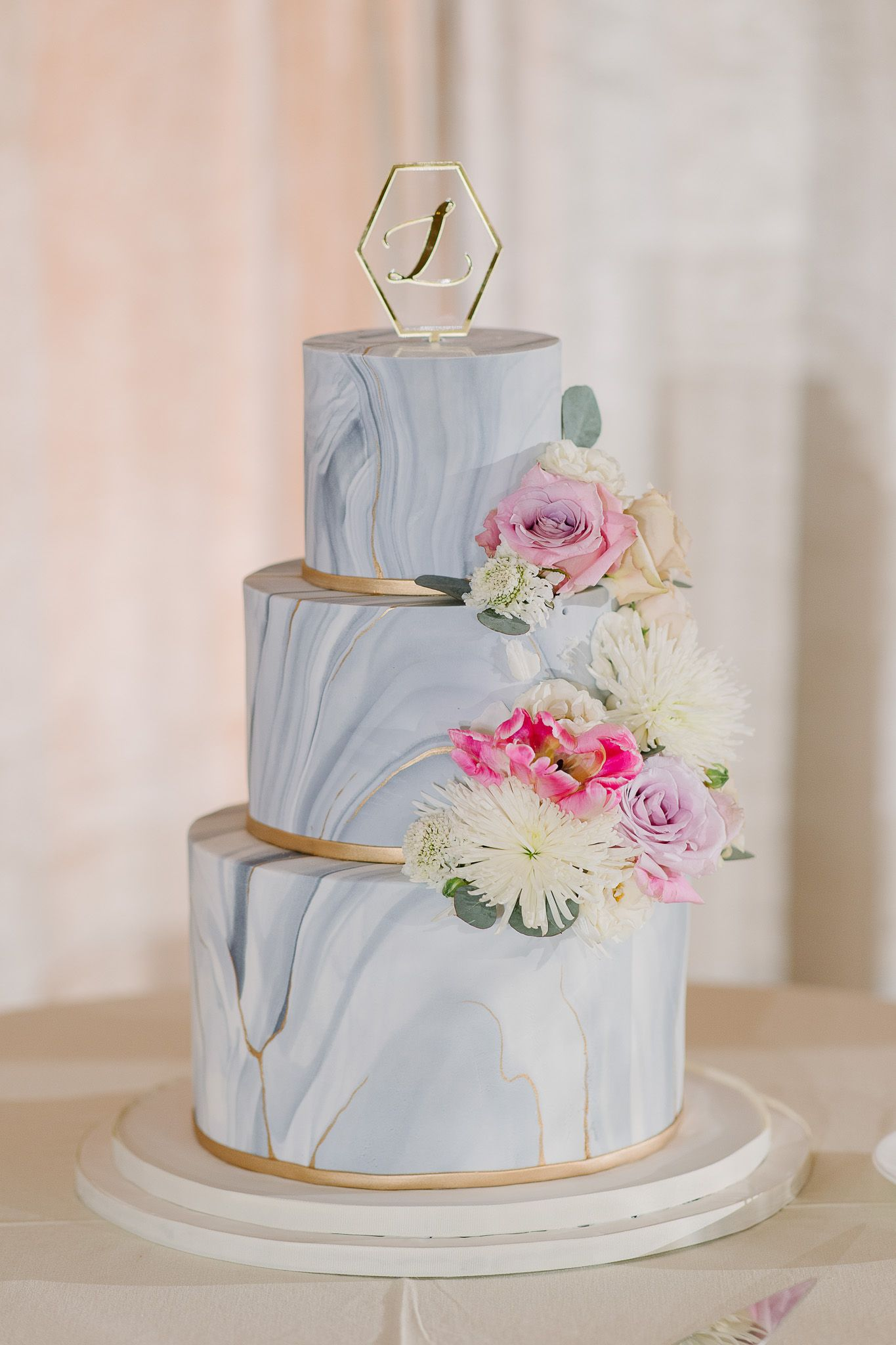 Stunning Wedding Cake With Marble Icing Tiers Dressed With Fresh