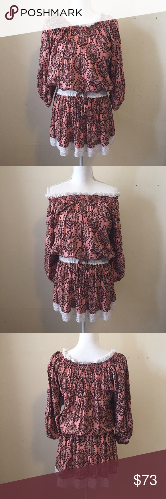 NWT Free People Coral Peasant Dress NWT Free People peasant dress in coral and black with white lace detailing at shoulder, waist, and hem. Elastic waist with drawstring. Top can be worn on or off shoulders.  Dress is 100% rayon with 100% cotton lining.  Brand new with tags. Size small. Free People Dresses Mini