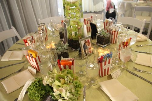 Cute table set-up.  And each table is a picture of a different movie (could be romance/wedding movies...or not). :)