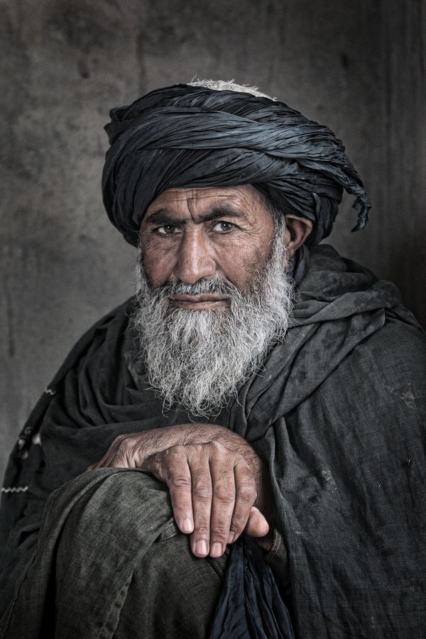 Afghan Elder by Lewis Whyld There's something to the dark color attire mixed with the light beard that really makes this portrait stand out.