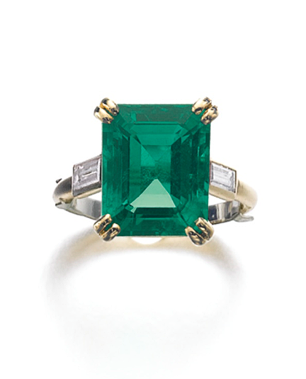 EMERALD AND DIAMOND RING, CARTIER Claw-set with a step-cut emerald weighing 5.69 carats, between baguette diamond shoulders, size 48, sizing band, signed Cartier, numbered, French assay and maker's marks, case stamped Cartier.