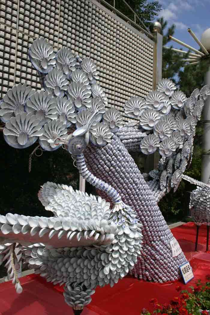 Part of a huge abstract sculpture made entirely of old aluminum cans in Urumchi, China. #RecycleArt