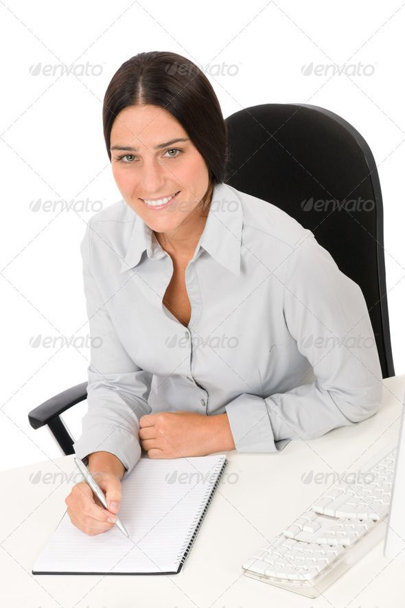 Successful Business Woman At Office With Notepad Alone