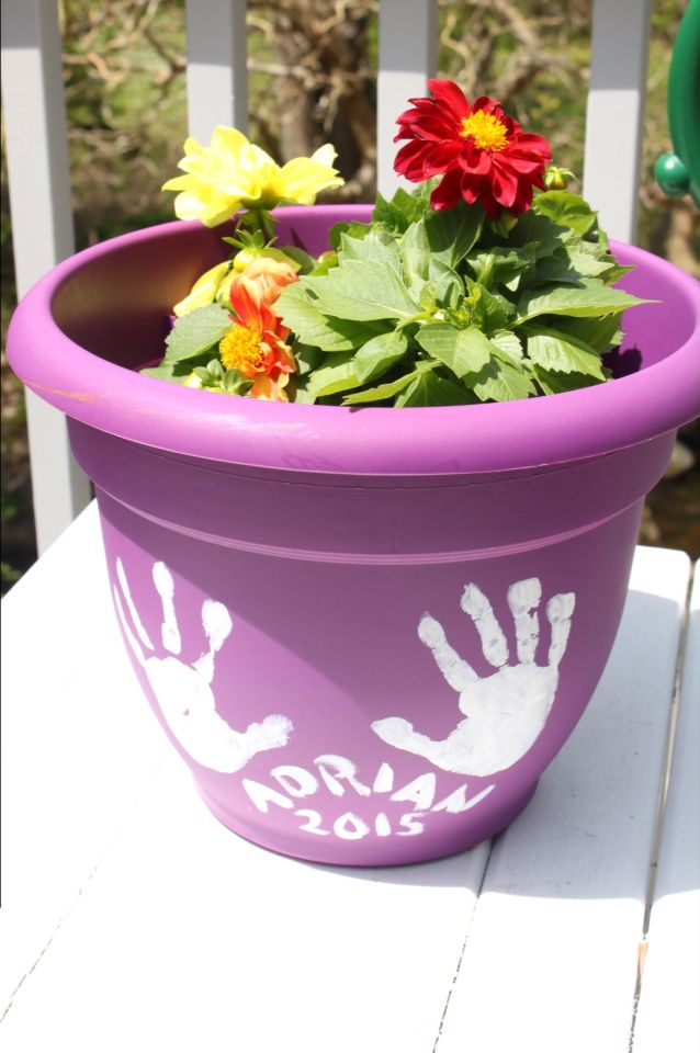 Happy Mother S Day Handprints Name And Year On A Plastic Flower Pot With Acrylic White Paint Mothers Day Flower Pot Plastic Flower Pots Flower Pots