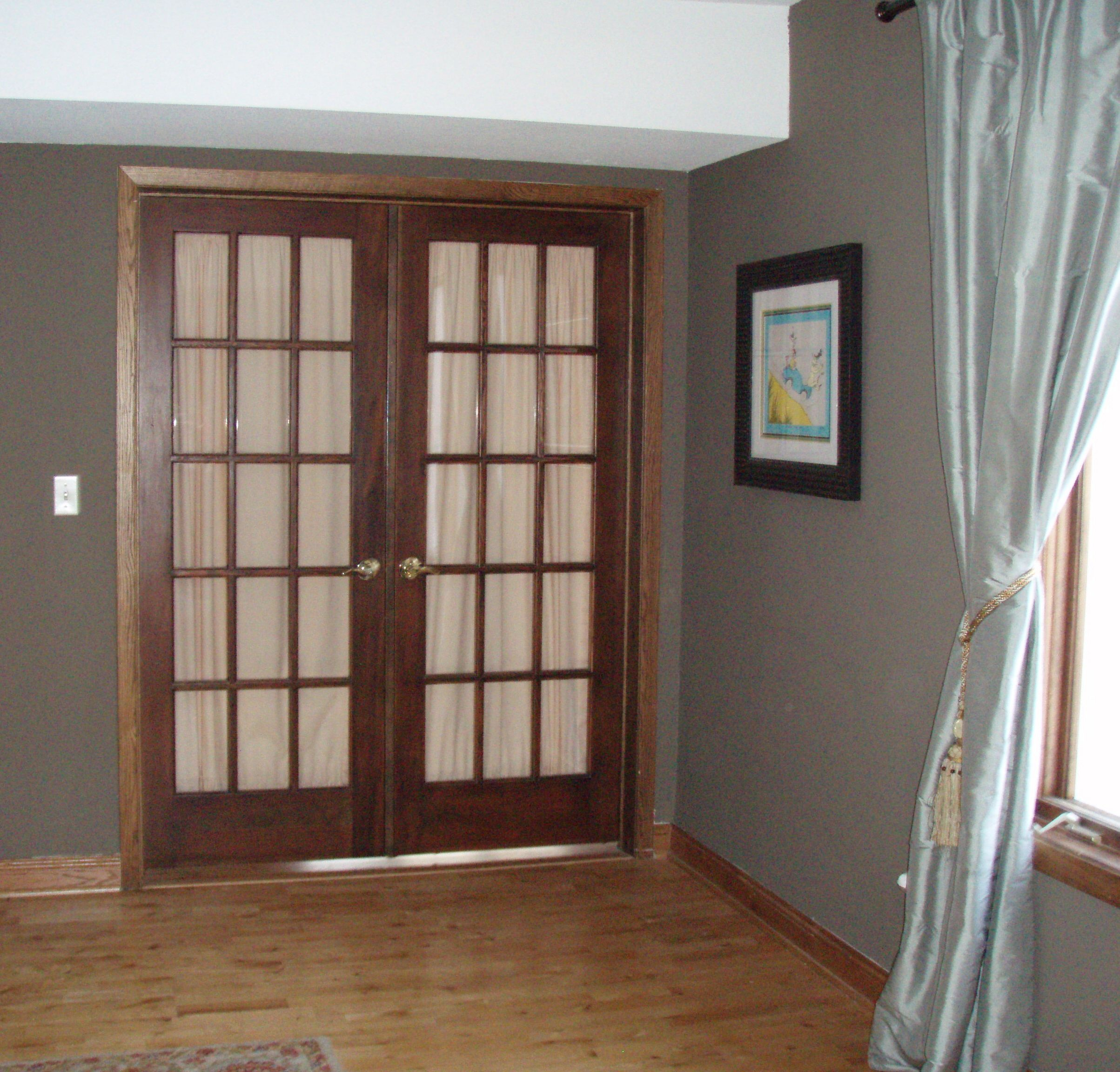 I like the french doors and wall color just white