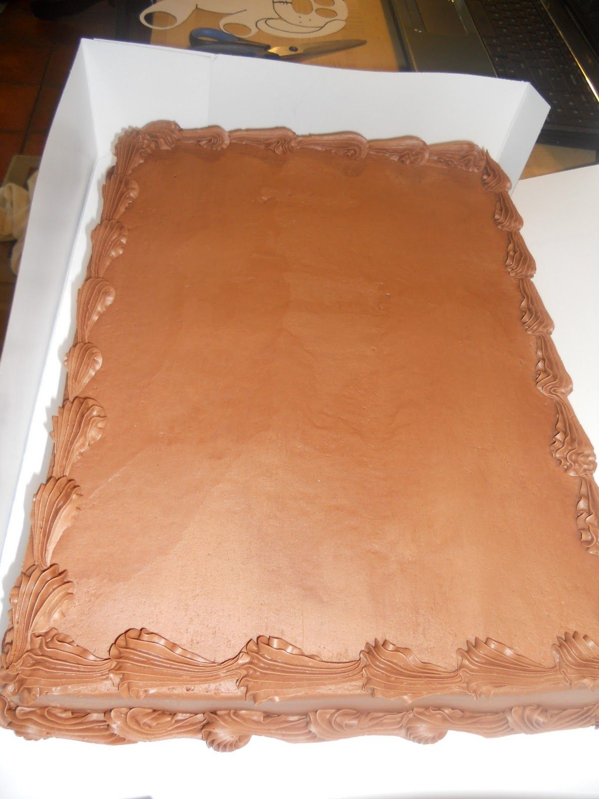 Plain costco chocolate sheet cake- will add a flower to coordinate ...