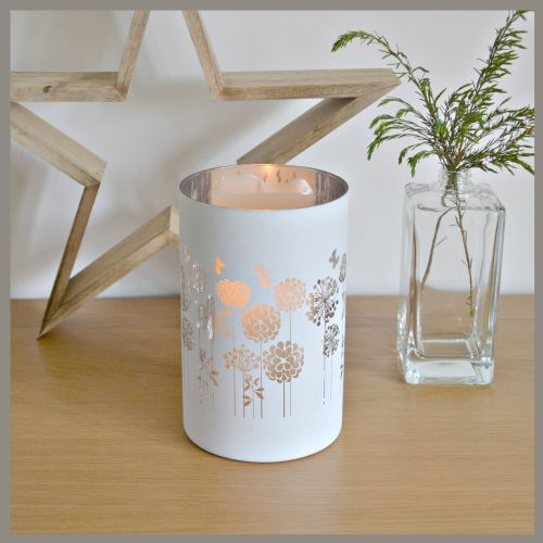 White & gold floral candle holder.