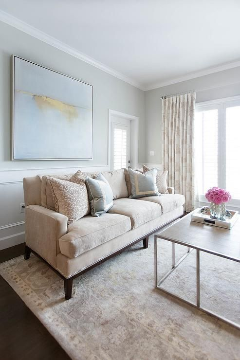 Surprising Exquisite Tan And Gray Living Room Boasts A Long Tan Sofa Gmtry Best Dining Table And Chair Ideas Images Gmtryco