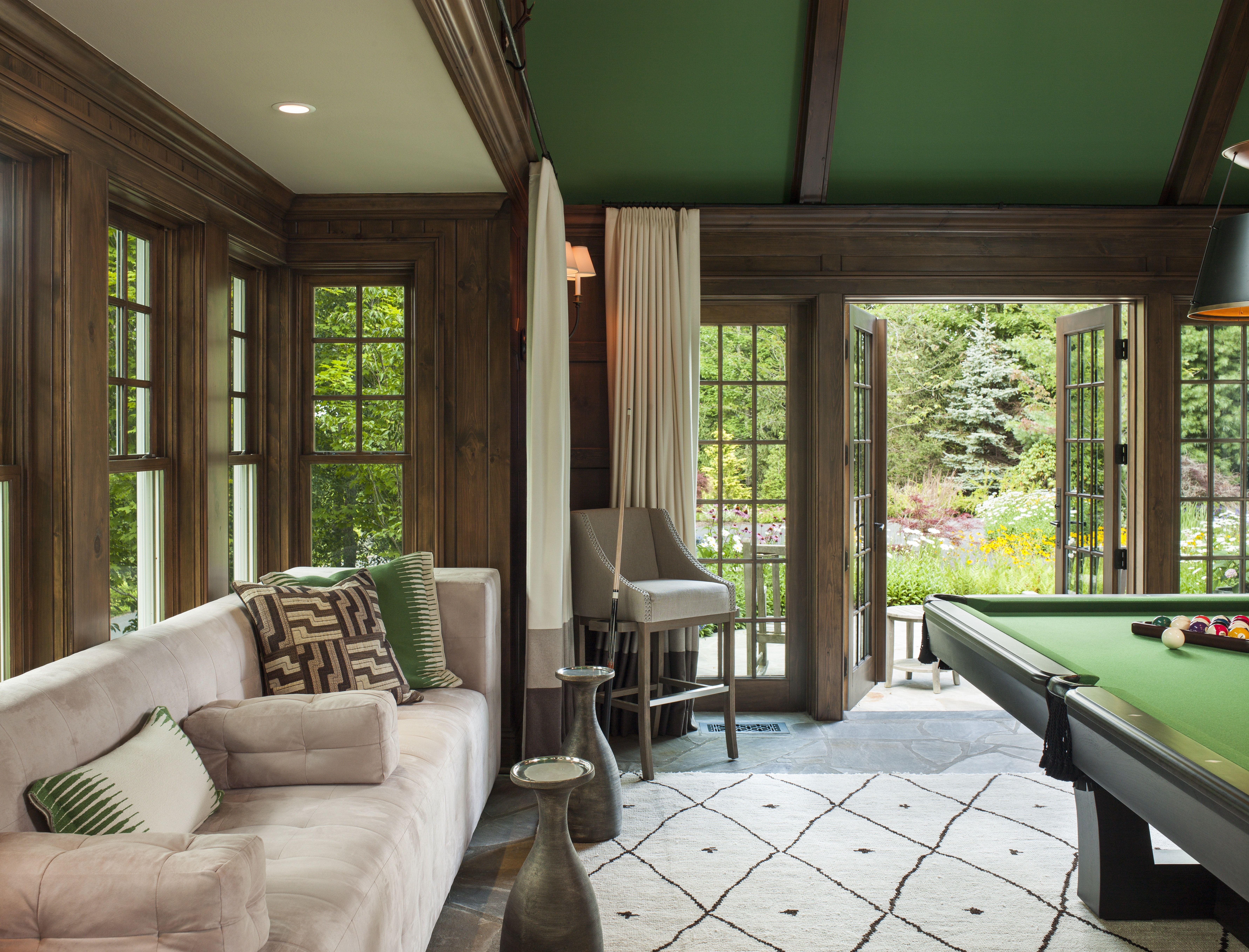 Deep green accents complement the wood tones in this