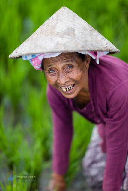 Portrait of Old Balinese woman working in the fields