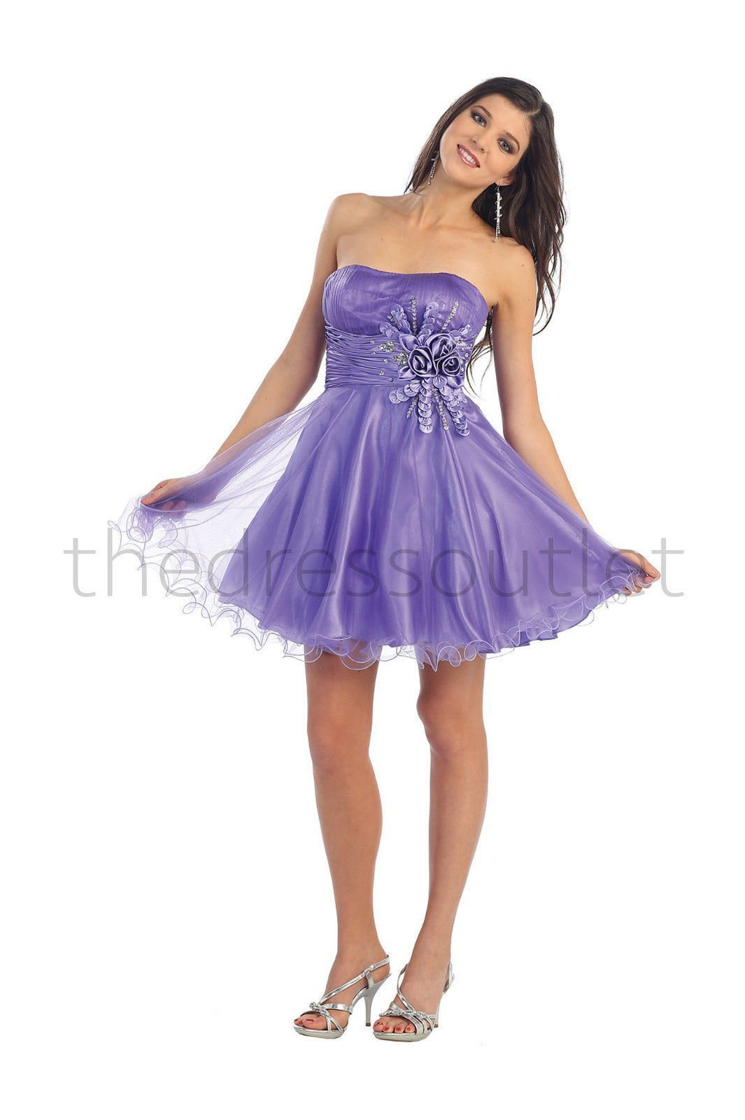A strapless sweetheart dress with a waist sash is accented with a