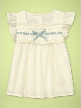 Sweet flutter-sleeve bow top, from baby Gap. I love the little hint of blue. Would go perfectly with a pair of baby blue jeans and this little bow http://www.bittybowsboutique.com/newborn-hair-bow-satin-lucy.html in Antique Blue.
