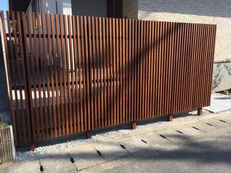 イタウバのデッキと縦格子フェンス 塗装あり 格子フェンス ウッドデッキ 塗装 縦格子