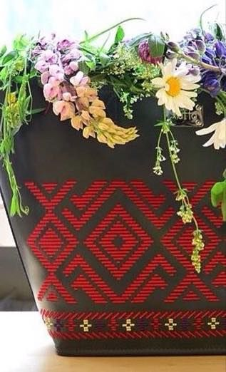 Lust tote in black leather with red embroidery, just in time for summer flowers. Practical, wear it anywhere handbag. #flowers #summer #designerbag