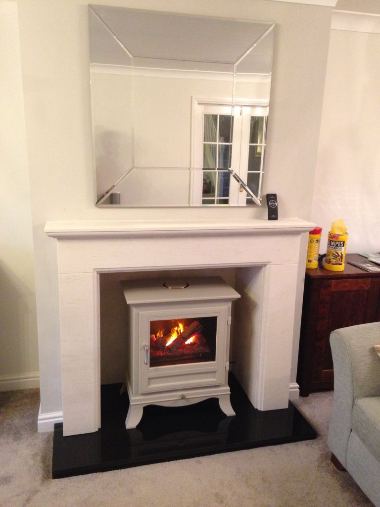 Chesneys Electric Stove And Limestone Fireplace Fitted By