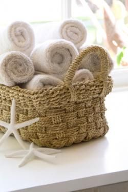 ROLLED TOWELS WICKER BASKET AND SOME STARFISH