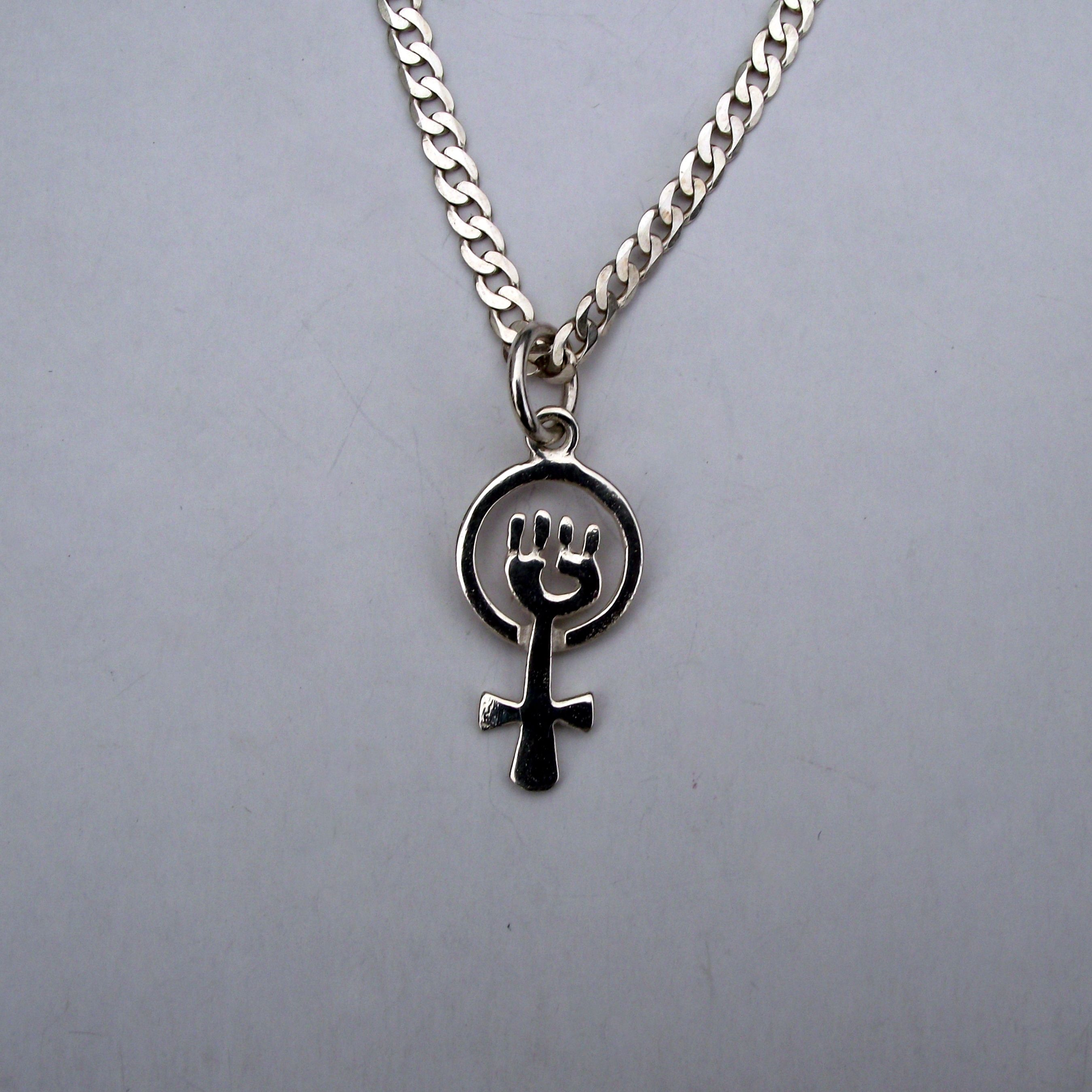 Woman clenched fist symbol jewelry
