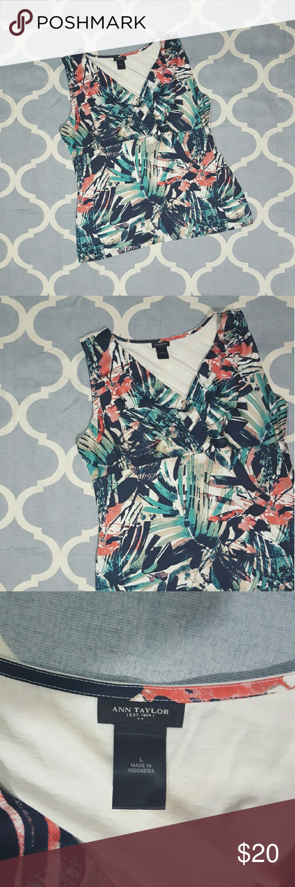"""Ann Taylor Blouse Sleeveless Sz large Green Red Ann Taylor women's blouse. Size Large. Sleeveless. Abstract green/black/red print. Polyester. In good used condition. B912&e. Length: 25""""  Chest: 20"""" Ann Taylor Tops Blouses"""