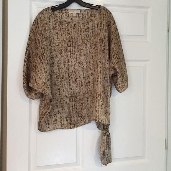 Michael Kors Top Michael Kors print blouse.  Brown & tan print ties at hip.  Goes great with brown pants & denim. Michael Kors Tops Blouses