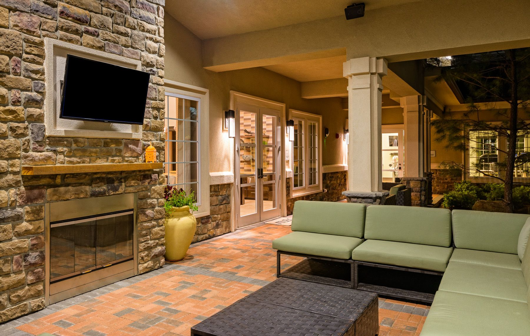 Stay Warm Near The Fireplace As You Watch Your Favorite Shows With Friends At Atley At The Greenway In Ashbur Virginia Apartments Modern Apartment House Styles