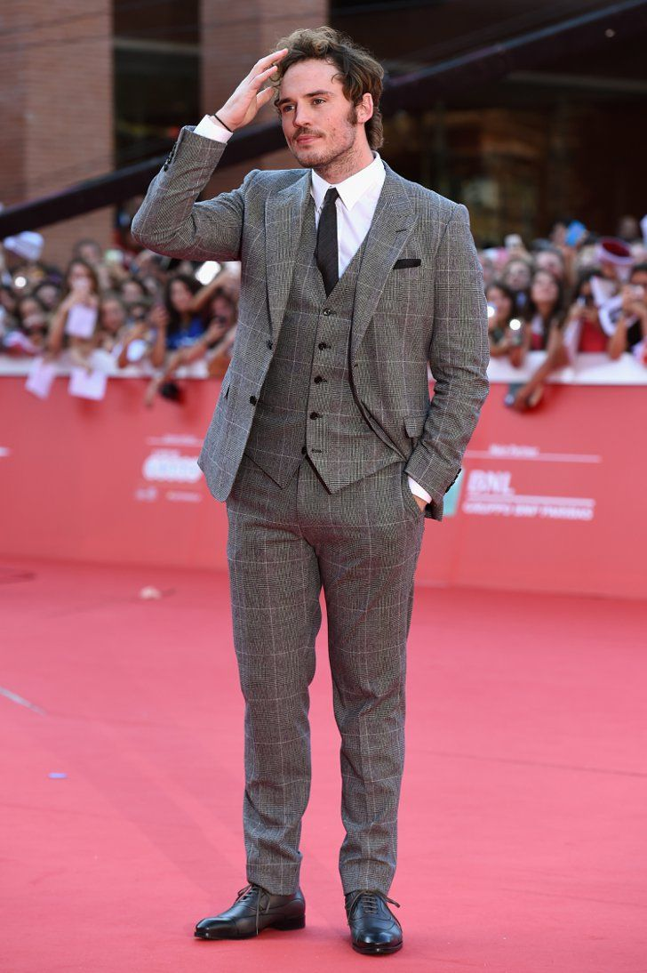 """Pin for Later: This Week's Can't-Miss Celebrity Photos  With this """"Is the gel holding up my hair enough"""" move, Sam Claflin is giving Robert Pattinson a run for his money."""