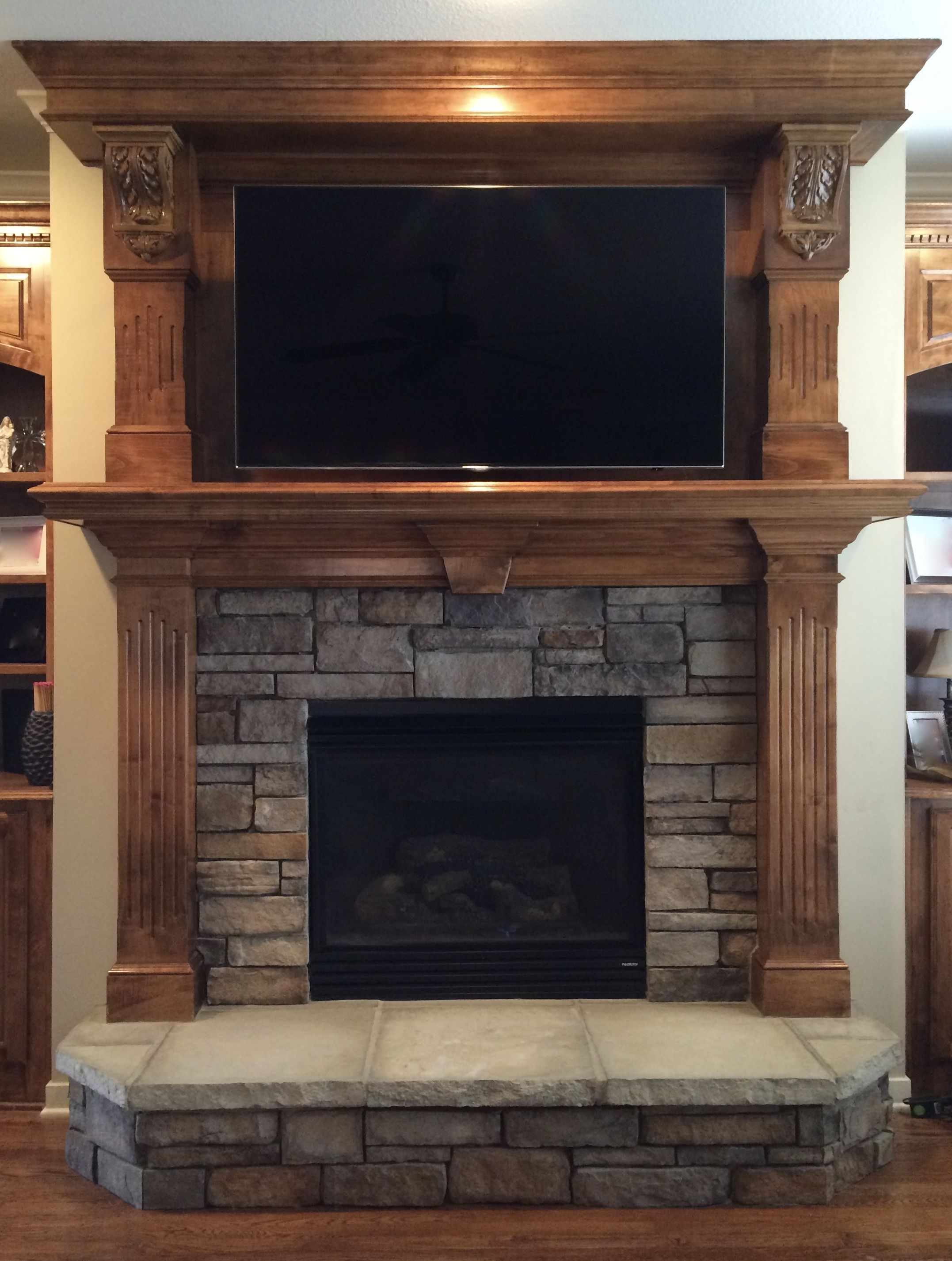 stacked stone replaces tile surround and hearth and tv with adjustable bracket mounted above. Black Bedroom Furniture Sets. Home Design Ideas