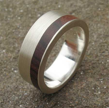 metal wood wedding band for groom I would replace the wood with